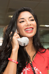September 11, 2018 - London, London, UK - London, UK.  Nicole Scherzinger at the 14th Annual BGC Charity Day held on the trading floor of BGC Partners in Canary Wharf, to raise money for charitable causes in commemoration of BGC's 658 colleagues and the 61 Eurobrokers employees lost on 9/11. (Credit Image: © Vickie Flores/London News Pictures via ZUMA Wire)