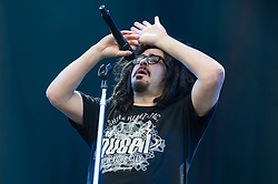 © Licensed to London News Pictures. 12/06/2015. Newport, UK.   Counting Crows performing live at Isle of Wight Festival 2015, Day 2 Friday.  In this picture - Adam Duritz.  This afternoon has seen torrential downpours of rain after the last day of hot sunshine.   Photo credit : Richard Isaac/LNP