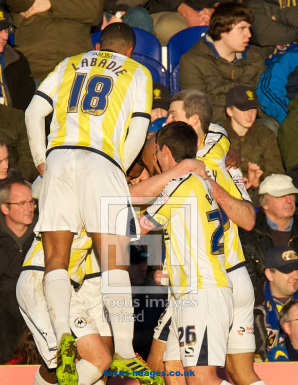 Picture by Alan Stanford/Focus Images Ltd +44 7915 056117<br /> 11/01/2014<br /> Krystian Pearce of Torquay United is congratulated by his team mates after scoring the opening goal during the Sky Bet League 2 match at the Cherry Red Records Stadium, Kingston.