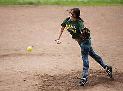 Lyla Weinstein delivers a pitch in the first inning as the Montclair softball league celebrates its 50th season, Saturday, April 22, 2017, at Montclair Park in Oakland, Calif. The pickup softball game, played every Saturday by a group of enthusiasts ranging in age from 20 to 75, started in 1968 in Berkeley and moved to Montclair about 25 years ago. (Photo by D. Ross Cameron)