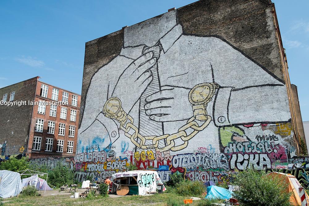Street art painted on apartment building walls in bohemian district of Kreuzberg  in Berlin Germany