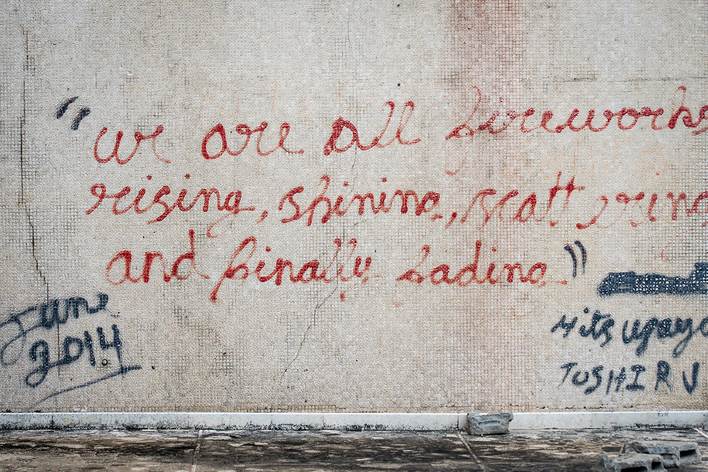 An inspirational quote graffitied onto the wall of the abandoned Ducor Hotel, once the most prominent hotels in Monrovia, Liberia.