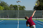 Andrew Ward, 11, serves to Hugo Moebel, 12, as the two practice at the Samuell Grand Tennis Center in Dallas, Texas on August 19, 2014. (Cooper Neill for The New York Times)