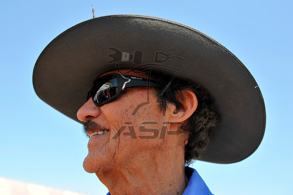 Brooklyn, MI - JUN 15, 2012: Richard Petty signs autographs in the garage during practice for the Quicken Loans 400 race at the Michigan International Speedway in Brooklyn, MI.