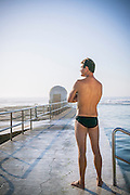 An Australian Lifeguard patrols Merewether Ocean Baths at Merewether Beach, NSW, Australia