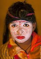 Young girl with Shiva make up. Maha Kumbh Mela festival, world's largest congregation of religious pilgrims. Allahabad, India.