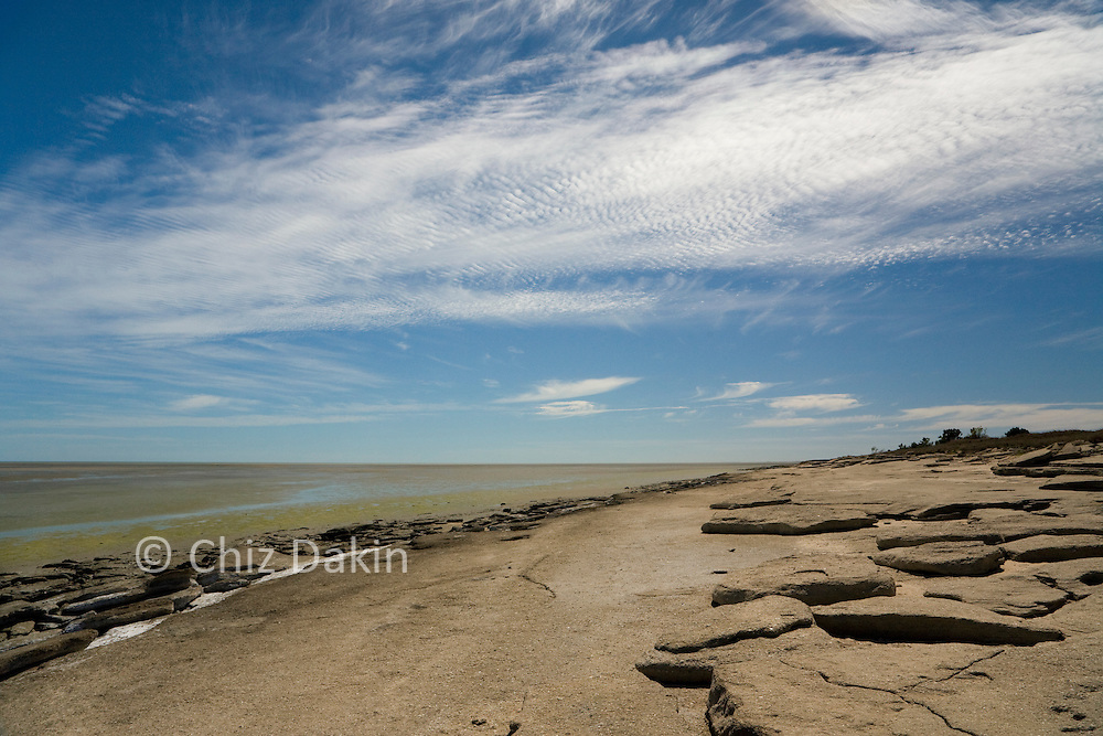 Ancient fossil rocks made of shells line the beach at Karumba on the Gulf of Carpenteria, in north-west Queensland, Australia.