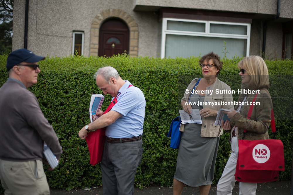 Pro-Union Better Together supporters out leafletting ahead of the Scottish referendum vote on independence, in Pollok district, Glasgow, Scotland, Thursday 26th June 2014.