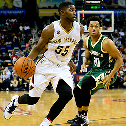 Nov 1, 2016; New Orleans, LA, USA; New Orleans Pelicans guard E'Twaun Moore (55) drives past Milwaukee Bucks guard Rashad Vaughn (20) during the second half of a game at the Smoothie King Center. Mandatory Credit: Derick E. Hingle-USA TODAY Sports