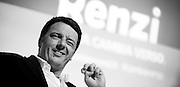 Matteo Renzi gestures during a political campaign convention for the Partito Democratico's primary elections -Italian left wing Party -  in Turin, December 6, 2013.
