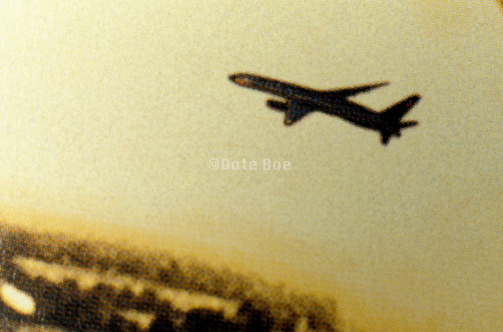 silhouette of airplane in flight