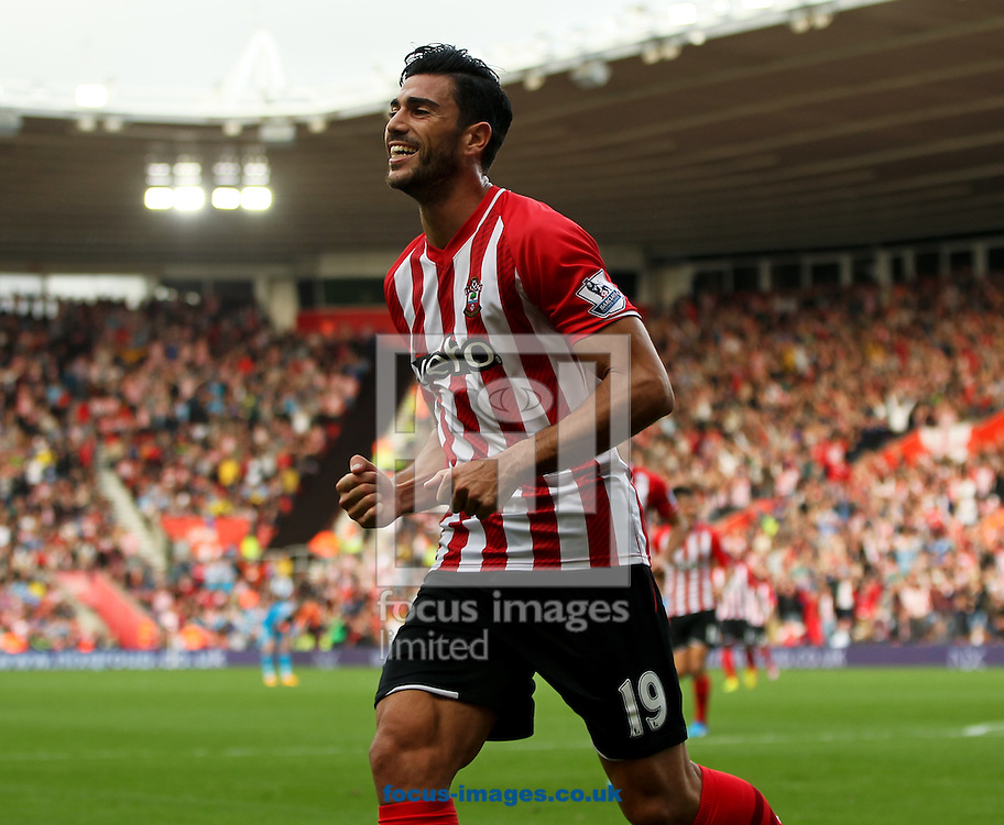 Graziano Pell&egrave; of Southampton celebrates scoring his sides fifth goal during the Barclays Premier League match at the St Mary's Stadium, Southampton<br /> Picture by Tom Smith/Focus Images Ltd 07545141164<br /> 18/10/2014