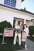 Happy Homeowners with  Sign
