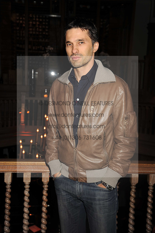 OLIVIER MARTINEZ at a party to celebrate the launch of Hollywood Domino - a brand new board game, held at Mosimann's 11b West Halkin Street, London on 7th November 2008.  The evening was in aid of Charlize Theron's Africa Outreach Project.