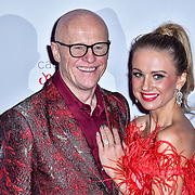 John Caudwell,Modesta Vzesniauskaite arrive at Float Like A Butterfly Ball for Caudwell Children Charity at Grosvenor House Hotel on 16 November 2019, London, UK.
