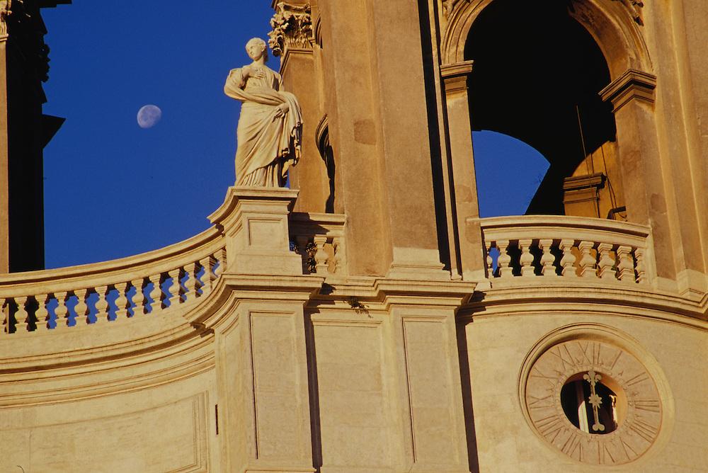 Europe, Italy, Lazio region,  Rome, historic stone building with moon through arch