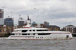 "© Licensed to London News Pictures. 16/06/2018. London, UK.  Bruce Grossman's 180 feet long superyacht, Forever One sails on the River Thames in London past  the Canary Wharf financial district before passing under Tower Bridge. Bruce Grossman is one of the richest men in Mexico (estimated net worth of USD1.5 billion) and shareholder of Arca Continental, the second largest Coca-Cola bottler in Latin America and third largest in the world. The unusual red colour scheme of the yacht reflects Grossman's significant Coca-Cola business interests and the yacht also features a reverse bow, fold-down balconies and a beach club with large window in the transom. The name Forever One refers to Bruce's wife Elsa, the childhood best friend of his younger sister and who later became Grossman's ""forever one""..  Photo credit: Vickie Flores/LNP"