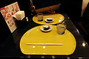 table with chopsticks and menu at a Japanese restaurant