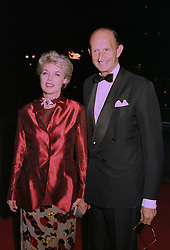MR & MRS DAVID METCALFE at an exhibition in London on 1st October 1997.MBU  24