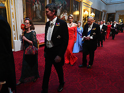 Leader of the House of Lords, Baroness Evans and Vice Admiral Sir Timothy Laurence arrive through the East Gallery during the State Banquet at Buckingham Palace, London, on day one of the US President's three day state visit to the UK.