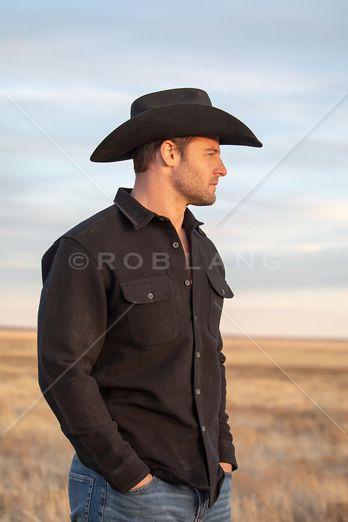 cowboy looking out on a ranch
