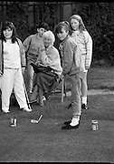 """Guinness Family Day At The Iveagh Gardens. (R83)..1988..02.07.1988..07.02.1988..2nd  July 1988..The family fun day for Guinness employees and their families took place at the Iveagh Gardens today. Top at the bill at the event were """"The Dubliners"""" who treated the crowd to a performance of all their hits. Ireland's penalty hero from Euro 88, Packie Bonner, was on hand to sign autographs for the fans...Picture shows the children taking part in theputting competition at the family day in the Iveagh Gardens."""