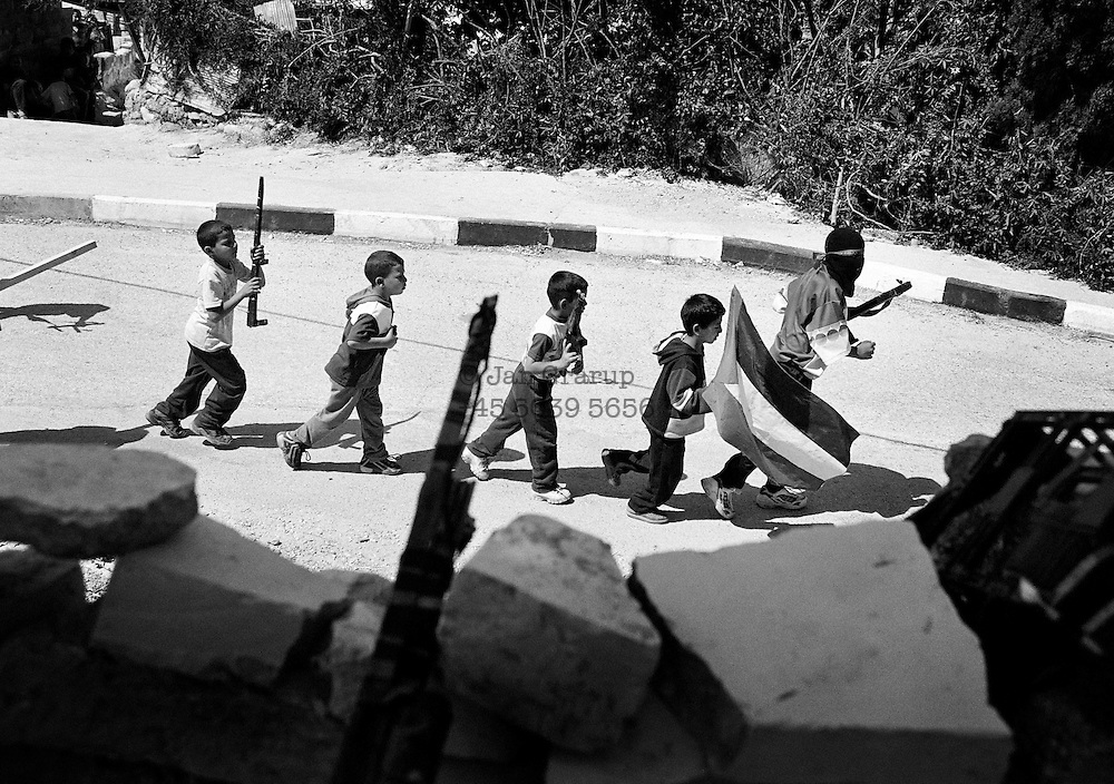 Small Palestinian boys are trained by the militant wing of Fatah, Tanzim. Nov.2002.