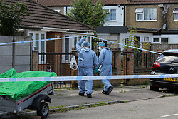 © Licensed to London News Pictures. 17/07/2020. London, UK. Forensic officers on Lytton Avenue, Enfield, in north London as police launch a murder investigation following the death of a man in his 30s. Police were called at 04:45hrs early this morning, to a report of four men fighting in Lytton Avenue, Enfield and a man being put into a vehicle. Later the victim died from a single stab wound in North Middlesex Hospital. Three men, no further details, have been arrested on suspicion of murder; all remain in custody. Photo credit: Dinendra Haria/LNP