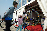A young girl checks out one of Garmin's rides.