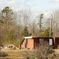 Thomas Wells   BUY AT PHOTOS.DJOURNAL.COM<br /> Only the front wall remains to a house in the Three Forks Community near Walnut on Monday following last weeks tornado.