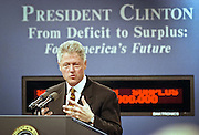 US President Bill Clinton standing in front of the new Budget Surplus Clock announces the first federal budget surplus in 29 years during an event at the White House September 30, 1998 in Washington, DC.