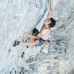 Adam Ondra redpointing Honour and Glory, at the Coliseum in Echo Canyon, Canmore, Alberta