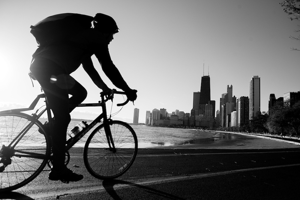 Lincoln Park Chicago Lakefront - A cyclist rides down the lakefront path in Chicago rounding the bend near North Avenue Beach.