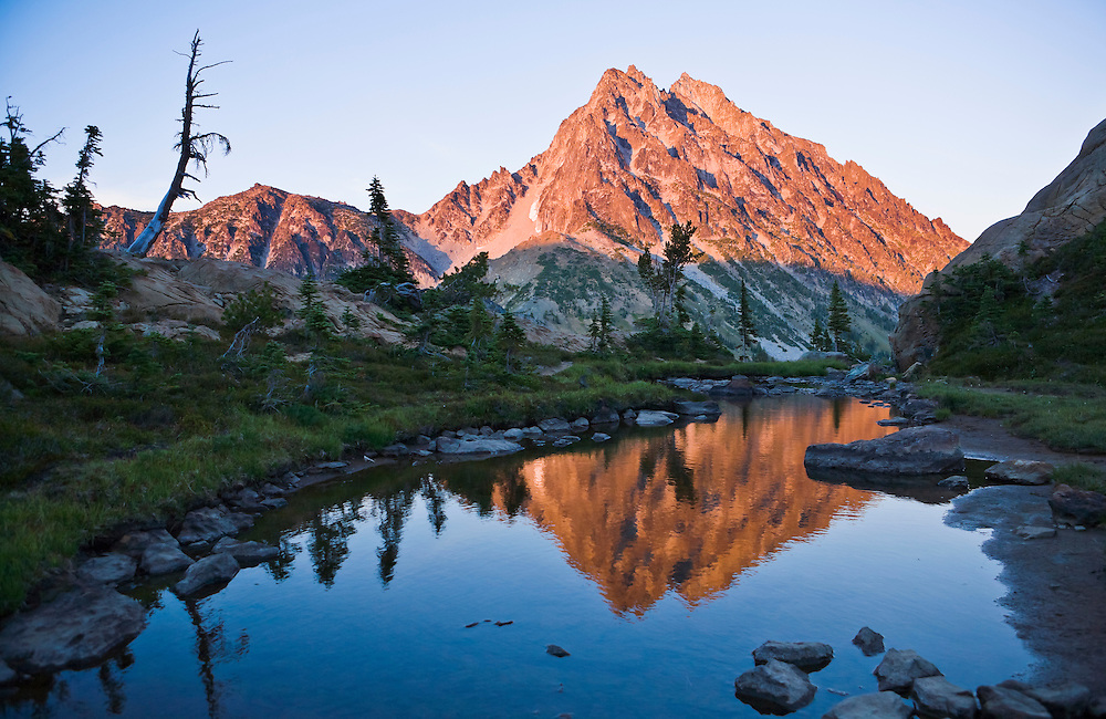 Mount Stuart reflected in still water at sunset Central Cascades Washington USA