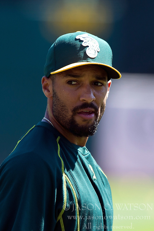 OAKLAND, CA - JUNE 21:  Marcus Semien #10 of the Oakland Athletics looks on during batting practice before the game against the Los Angeles Angels of Anaheim at O.co Coliseum on June 21, 2015 in Oakland, California. The Oakland Athletics defeated the Los Angeles Angels of Anaheim 3-2. (Photo by Jason O. Watson/Getty Images) *** Local Caption *** Marcus Semien