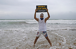 September 9, 2017 - Miami, FL, USA - Javier Narvaez poses for as his daughter Juliana, not pictured, takes a photo at Miami Beach as the outer bands of Hurricane Irma reach South Florida early on Saturday, Sept. 9, 2017. (Credit Image: © David Santiago/TNS via ZUMA Wire)