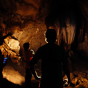 Andrew Whiteford, Jay Goodrich and Win Jalawin explore the Chiang Dao Cave with a local guide in the jungle near Chiang Dao, Thailand.