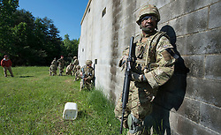 Image shows Colour Sergeant Marin Hylton and other troops from 77 Brigade exercising with the United States Marine Corps and Army at Quantico Marine Corps Base, Quantico Virginia. <br /> <br /> 22/05/2015<br /> <br /> Elements of 77X are working with American troops on Combined Unit Exercise (CUX) 15.2 - a 3 week exercise meant to test Marine Corps Information Operations Centre (MCIOC) personnel in a variety of Information<br /> Operation techniques. <br /> <br /> <br /> Credit should read: Cpl Mark Larner RY