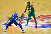 Boston Celtics Kyrie Irving (11) stares down Philadelphia 76ers Jerryd Bayless (0) during the NBA London Game match between Philadelphia 76ers and Boston Celtics at the O2 Arena, London, United Kingdom on 11 January 2018. Photo by Martin Cole.