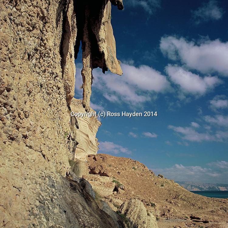 Stalactites on cliff in coastal Dhofar