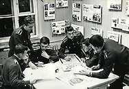 A scene from the Moscow military trade school in Leningrad during the Soviet Union. An exhibit about the Vietnam War in on display in the background. The Soviet Union sent military advisors to help fight against the United States during the Vietnam War. ..Russian military school at the Leningrad State University in 1969 which was celebrating 100 years of the birth of Lenin.