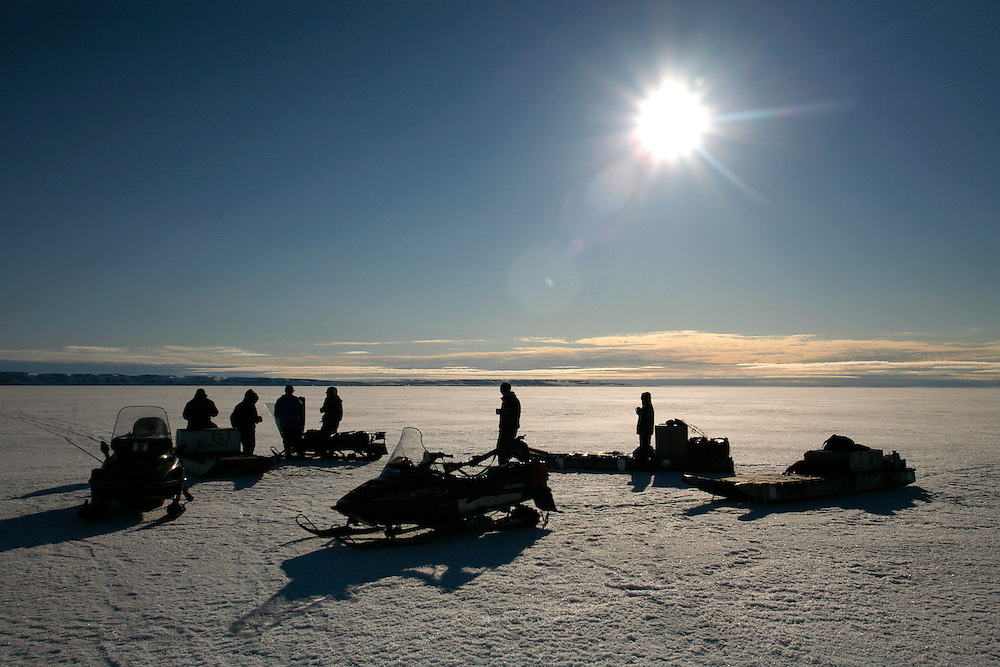 Inuit hunters smoke while taking a break from seal hunting in Resolute Bay, Canada on Tuesday, June 12, 2007. Inuit hunters hunt seals for food, and their community uses every part of the seals, either eating the meat or using the hides to make warm clothes. The traditional way of life in the Resolute Bay Inuit community is being threatened by rising temperatures. The dangers of global warming, which have been extensively documented by scientists, are appearing first, with rapid, drastic effects, in the Arctic regions where Inuit people make their home. Inuit communities, such as those living on Resolute Bay, have witnessed a wide variety of changes in their environment. The ice is melting sooner, depleting the seal population and leaving them unable to hunt the animals for as long. Other changes include seeing species of birds and insects (such as cockroaches and mosquitoes) which they have never encountered before. The Inuit actually lack words in their local languages to describe the creatures they have begun to see.