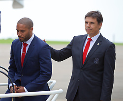 CARDIFF, WALES - Saturday, June 4, 2016: Wales manager Chris Coleman gives captain Ashley Williams a pat on the back after the team had posed for a photograph on the steps of the plane at Cardiff Airport as the squad head to Sweden for their last friendly before the UEFA Euro 2016 in France. (Pic by Paul Greenwood/Propaganda)