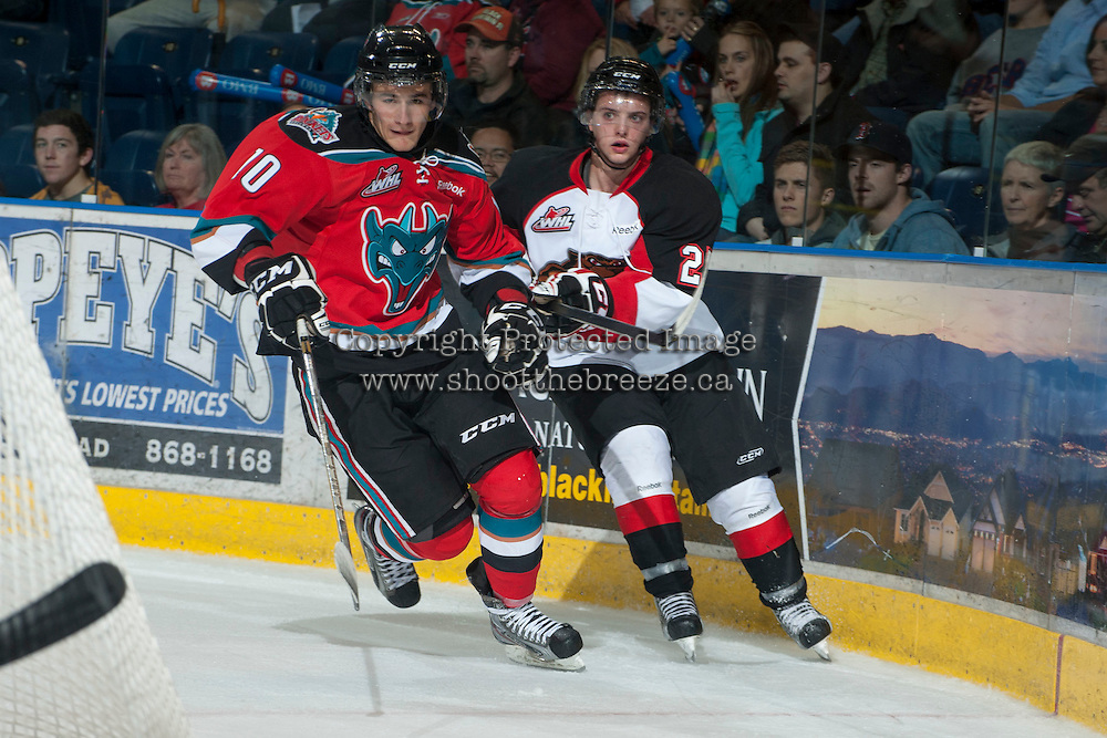 KELOWNA, CANADA - NOVEMBER 3:  Filip Vasko #10 of the Kelowna Rockets is checked by Joseph Carvalho #25 of the Prince George Cougars at the Kelowna Rockets on November 3, 2012 at Prospera Place in Kelowna, British Columbia, Canada (Photo by Marissa Baecker/Shoot the Breeze) *** Local Caption ***