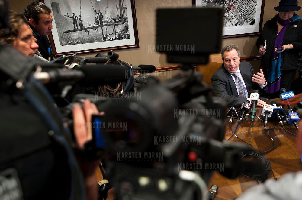 January 21, 2014 - New York, NY : <br /> David H. Perecman, attorney for the family of Avonte Oquendo, held a press conference at his office at 250 West 57th Street in Manhattan on Tuesday afternoon to announce that the remains <br /> discovered along the East River in Queens last week were matched to the missing autistic teenager. Pictured here, Mr. Perecman, seated at center right, speaks with reporters.<br /> CREDIT: Karsten Moran for The New York Times