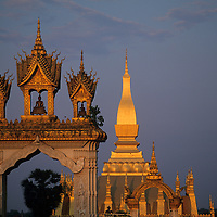 Asia, Laos, Vientiane, Setting sun lights  Pha That Luang Temple on summer evening