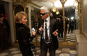 Karl Lagerfeld and Lily Safra, Aids beneft during couture week, Pavilion D'Armee Nonville, 21 January 2004. © Copyright Photograph by Dafydd Jones 66 Stockwell Park Rd. London SW9 0DA Tel 020 7733 0108 www.dafjones.com