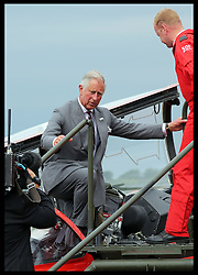 Image licensed to i-Images Picture Agency. 11/07/2014. Windsor, United Kingdom. The Prince of Wales climbs out of the cockpit of a Red Arrows jet after he met the pilots as part of the celebrations for  the Red Arrows 50th anniversary display season at the Royal International Air Tattoo at RAF Fairford, Gloucestershire,  United Kingdom. Picture by Stephen Lock / i-Images