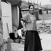 Roma in the illegal camp of Zitkovac in the outskirts of Mitrovice.  The camp lies next to the rubbish dump of the town. Roma are unwanted by both the Serbian and the Kosovan side of the town. They survive with some support from humanitarian organisations and by selling things they found in the skips.