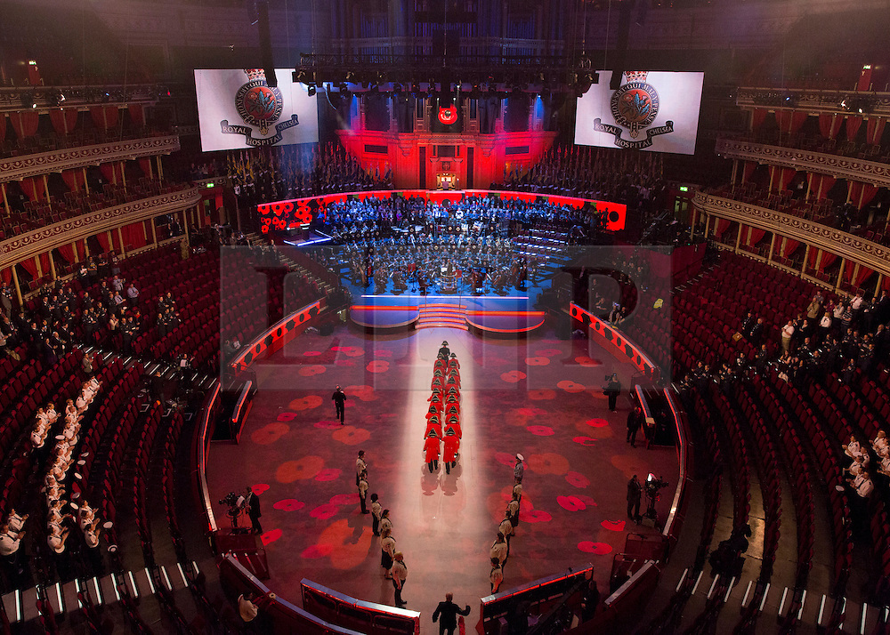© Licensed to London News Pictures. 07/11/2014.  London.  Royal Chelsea pensioners march into the arena of the Royal Albert Hall as they practice their entrance ahead of today's Festival of Remembrance.  First broadcast in 1927 the festival has now been held in the Royal Albert Hall for 87 years.  Photo credit : Alison Baskerville/LNP